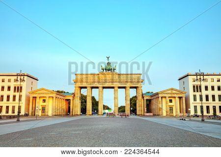 Brandenburg Gate (brandenburger Tor) In Berlin, Germany At Sunrise