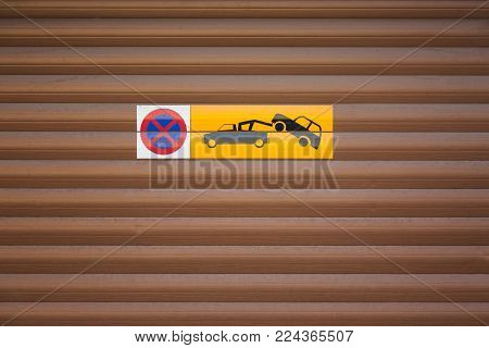 Towing car. Evacuation sign. No parking on wooden background