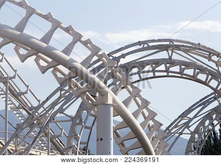 Design roller coaster against the sky . In the park in nature