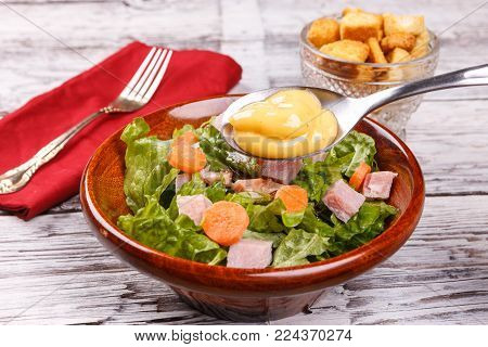 Salad with honey mustard dressing. Close up of a delicious salad with honey mustard dressing.