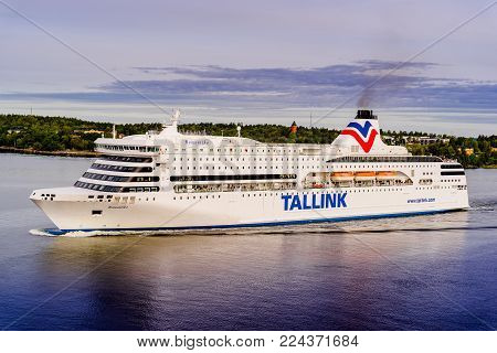 STOCKHOLM, SWEDEN - September, 2017 Bright cruise shipTallink is going among archipelago in Sweden. Tallink is an Estonian shipping company that operates cruiseferries between Finland, Sweden, Latvia