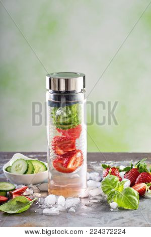 Infused water with strawberry, cucumber and basil, refreshing spring drink recipe