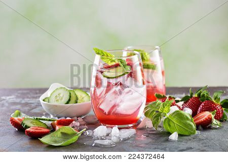 Refreshing spring or summer cocktails with strawberry, basil and cucumber