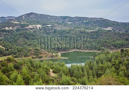 The Palaichori dam among the pines in Troodos mountains, Nicosia District, Cyprus.