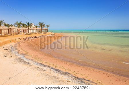 Parasol on the beach of Red Sea in Hurghada, Egypt