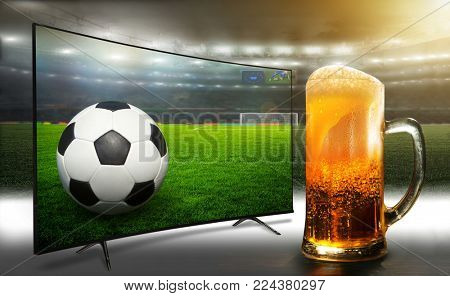 Football match from the stadium. TV broadcast of the match. Fans like to drink beer when watching a match.