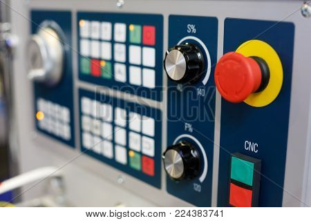 Closeup of the control panel of CNC machining center. Selective focus.
