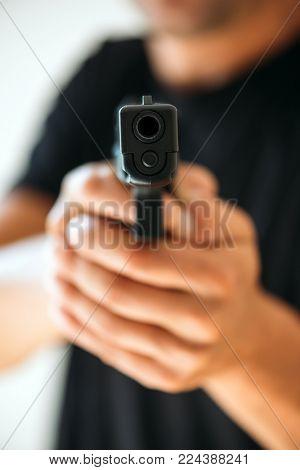 Men with handgun closeup. Criminal aggression concept