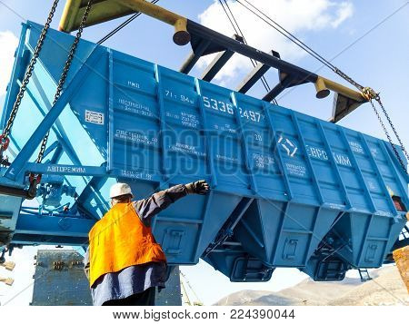 Novorossiysk, Russia - October 10, 2017: Wagon of the hopper for unloading on a cargo ship. Lifting operations in the port.