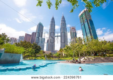 modern buildings in kuala lumpur in blue sky from low angle view