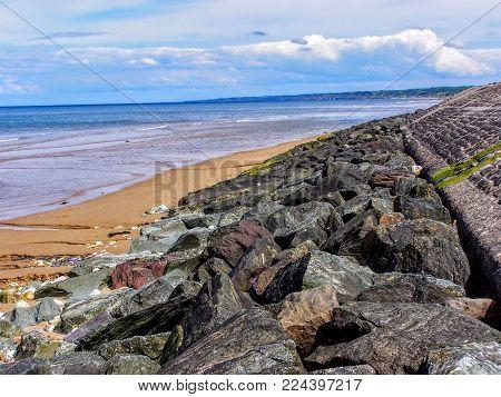 France, Calvados, Colleville Sur Mer, Omaha Beach, Beach Of The Landing Rocks And Ocean, Blue Sky An