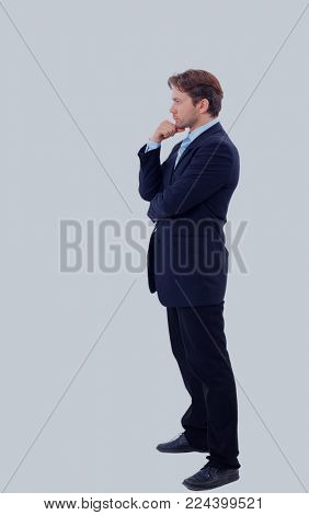 Full length profile of a middle aged business man.