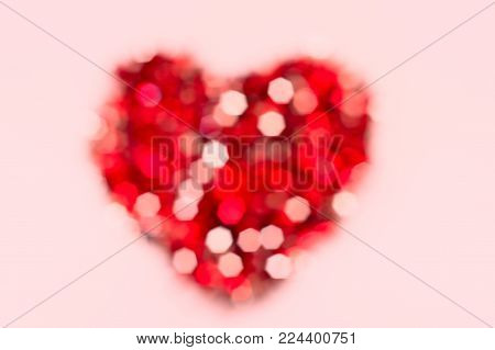 Blurred red heart shape,glitter bokeh on white background.Red heart is a symbol of love,romantic,glitter of bokeh like as beautiful love. For Valentine's day concept or use for background template