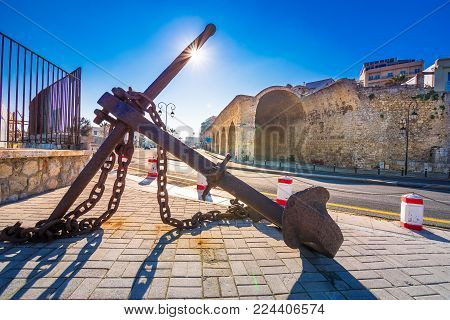 Heraklion harbour with rusty anchor and shipyards, Crete, Greece