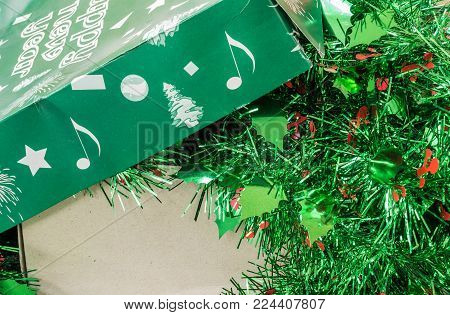 Closeup Pile Of Christmas Decoration In A Green Box Background