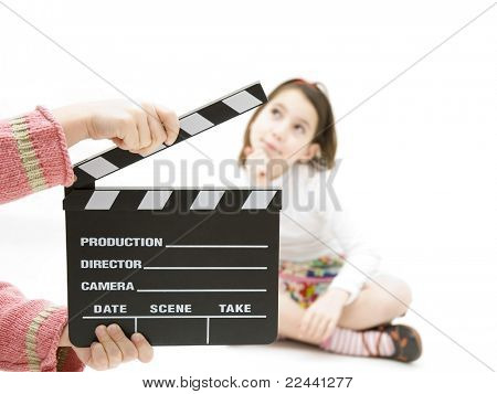 young girl with a movie clapper isolated on white background