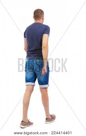 Back view of going  handsome man. walking young guy . Rear view people collection.  backside view of person.  Isolated over white background. The guy in denim shorts goes by.
