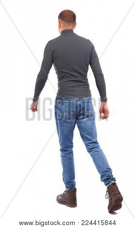 Back view of going  handsome man. walking young guy . Rear view people collection.  backside view of person.  Isolated over white background. A man in a gray sweater quickly goes away.