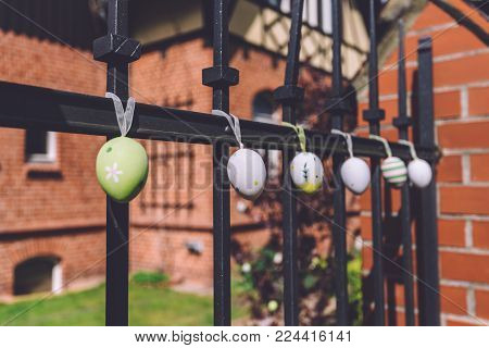 April, 14th, 2017 - Potsdam, Brandenburg, Germany. Traditional festive Easter handmade decorated eggs near rural cottage during Easter celebration in Potsdam.