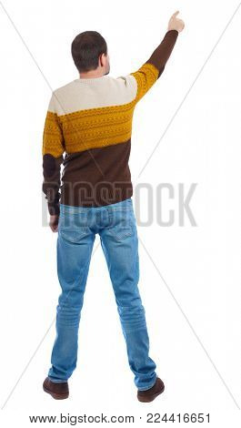 Back view of  pointing young men in  shirt and jeans. Young guy  gesture. Rear view people collection.  backside view of person.  Isolated over white background. A man in a striped sweater looks up.