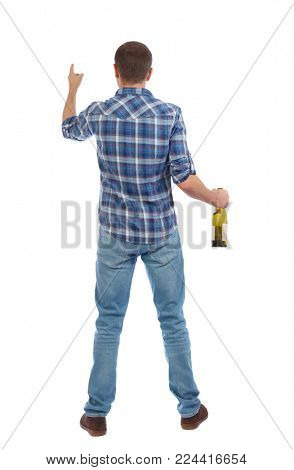 Back view of drunk man with  bottle of wine. drinking young guy. Rear view people collection.  backside view of person.  Isolated over white background.  A drunk man treats something in front of him