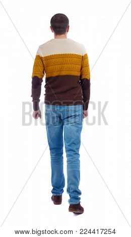 Back view of going  handsome man. walking young guy . Rear view people collection.  backside view of person.  Isolated over white background. An adult man in a brown sweater goes to the distance