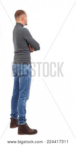 Back view of man in jeans. Standing young guy. Rear view people collection.  backside view of person.  Isolated over white background. a short-cut man standing with his back with his hands on his che