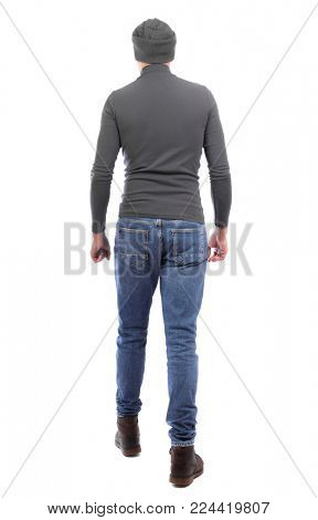 Back view of going  handsome man. walking young guy . Rear view people collection.  backside view of person.  Isolated over white background. A man in a gray sweater and a hat goes away