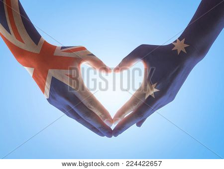 Australia national flag  on people hands in heart shape isolated on sky background for labour day and national holiday celebration