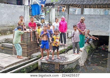 LOMBOK, INDONESIA - DECEMBER 30, 2016: Children playing outside in Lombok, Indonesia on 30th december 2016