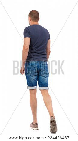 Back view of going  handsome man. walking young guy . Rear view people collection.  backside view of person.  Isolated over white background. A boy in denim shorts goes to the side.