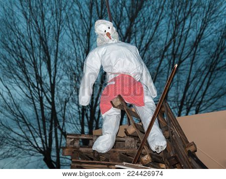 White Puppet Ready to be Burned in Wood Campfire.
