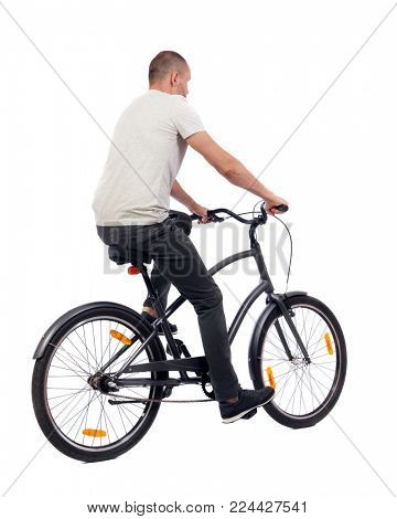 back view of a man with a bicycle. cyclist rides a bicycle. Rear view people collection.  backside view of person. Isolated over white background. A guy in a white sweater on a retro bicycle ride