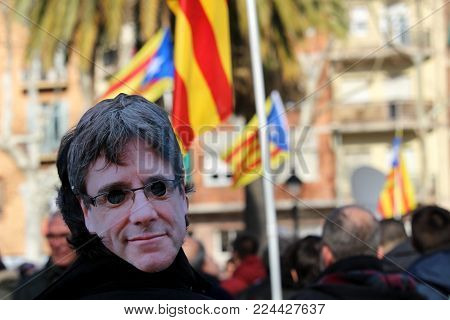 Barcelona, Spain - January 30, 2017: Concentration Of People Wearing A Mask With The Face Of Carles