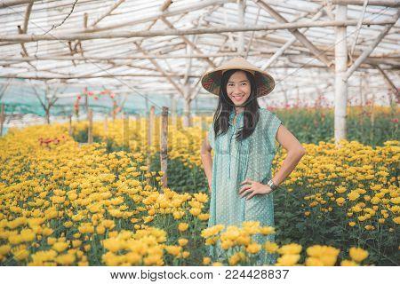 portrait of beautiful asian woman in the flower farm