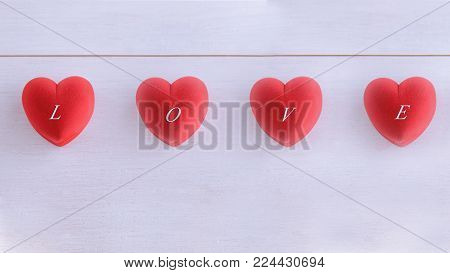 Red hearts with words LOVE for Saint Valentines day. Large background for banner, card, website, poster.