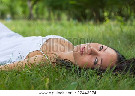 Portrait Of A Girl Lying On Grass