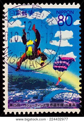 Moscow, Russia - January 31, 2018: A stamp printed in Japan shows Skydivers in the sky, dedicated to the 25th World Parachuting Championships, series