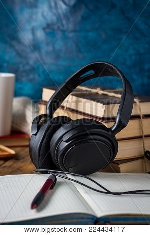 Books, Headphones, Outdoor Diary On A Wooden Background. The Concept Of Audio Books And Audio Traini