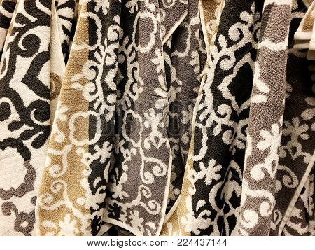 Towels stack. Shower towels. Terrycloth towels in pile for selling. Home decor cloth in department store. Terry towels vertical pile on shelf.