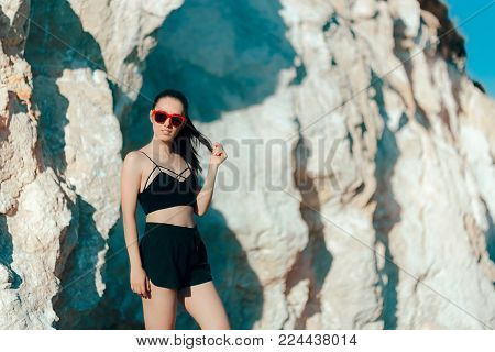 Cool Sportive Woman Wearing Sports Bustier, Shorts and Sunglasses