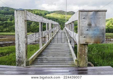 The Jubilee Bridge close to castle Stalker in Appin with breathtaking view of mountains in the background, Argyll, Scotland