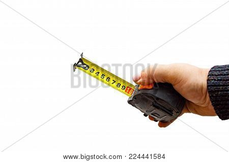 Measuring tool. Hand with a tape measure isolated on white background