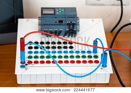 Electric educational device white color with the wires on the table