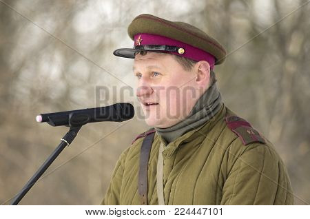 St. Petersburg, Russia - February 23, 2017: The Soviet officer with signs of distinction in celebration of the Day of Defender of the Fatherland. Historical reenactment.