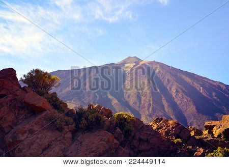 View of volcano El Teide with volcanic rocks in the foreground.Mount Teide at sunset.Teide National Park,Tenerife,Canary Islands, Spain.Selective focus.