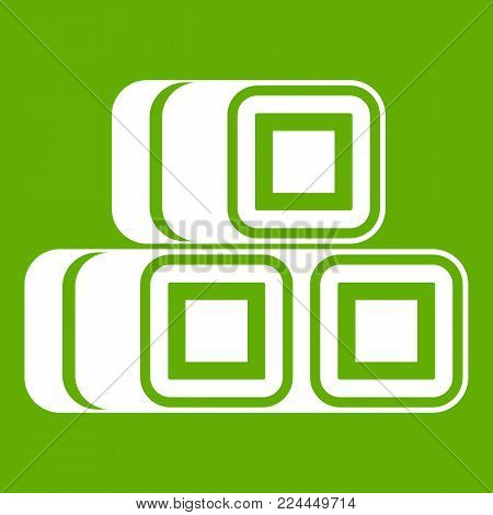 Hay bundles icon white isolated on green background. Vector illustration