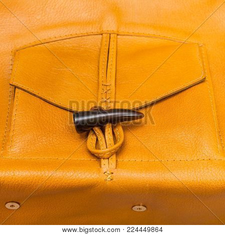 pocket of handmade yellow leather bag close up