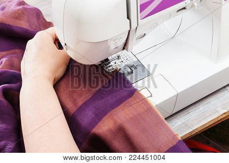 workshop on sewing a patchwork scarf - designer hems strips of fabrics for the future silk shawl with sewing machine