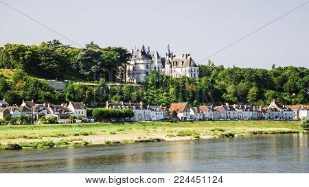 Travel to France - view of houses on island Ile d'Or and castle in Amboise town near Loire river